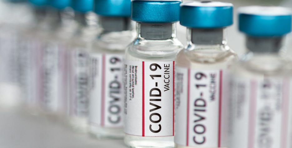 Covid-19 Coronavirus Vaccine vials in a row macro close up